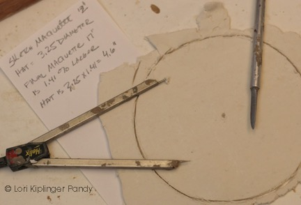 Photo cutting a hat armature template in paperclip ©Lori Kiplinger Pandy