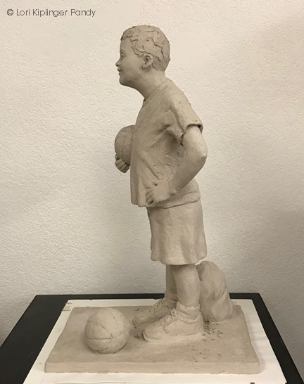 Boy with Down syndrome sculpture ©Lori Kiplinger Pand
