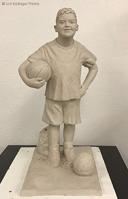 Boy with Down syndrome sculpture ©Lori Kiplinger Pandy
