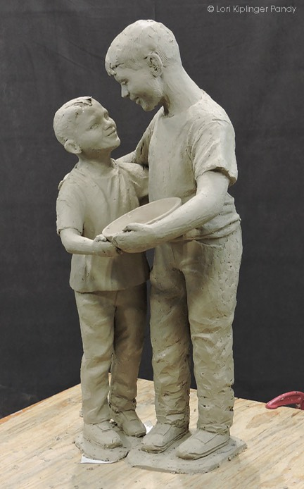 Continuing to work on the clothing in sculpting two boys ©Lori Kiplinger Pandy