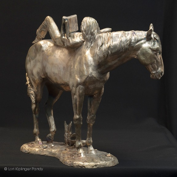 raw bronze girl reading on horseback ©Lori Kiplinger Pandy